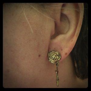 Gold tone Rose earrings.